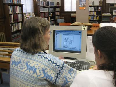 Sandy demonstrates online information.