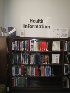 New, improved section of Holyoke Public Library reference collection. Kathleen Packard helped Michael Baron weed outdated materials. HCHL purchased many new books.