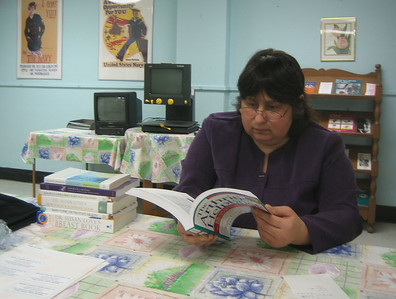 Stephanie examines the new books we brought.