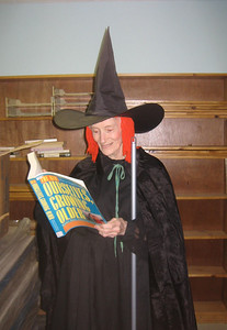 A well-costumed senior reads Ourselves Growing Older.  Halloween 2005.