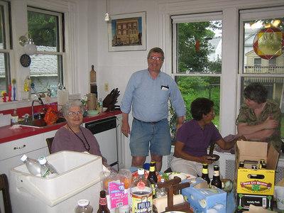 The party moved into the kitchen.  Naomi, Jim Craig, Doris, Mary Glackin