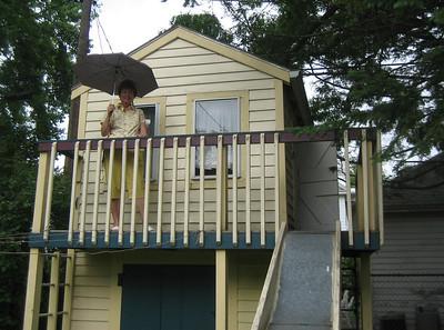 Elaine surveys the yard from the playhouse.  A light rain was falling.