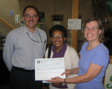 Javier, Doris, and Sandy pose with the copy of $10,000 check from NN/LM.  June 14, 2006