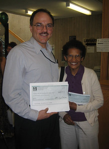 Javier Crespo of the New England Regional office of the National Network of Libraries of Medicine (NN/LM) drove to Holyoke to deliver the $10,000 Express Outreach Award for our summer project.    Doris McKethan, HCHL Treasurer, is holding the real check, while Javier holds a copy.