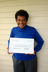 HCHL Treasurer Doris McKethan happily received the check!