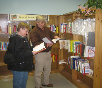 Chris and Jim Craig viewing HCHL books at Senior Center. They have been active HCHL supporters for years.