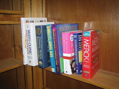 Dan and I decided to put the books (temporarily) on an unused shelf  beside the existing Caregivers Resource Library until CoA staff member Stephanie Merrick has time to decide the permanent location.