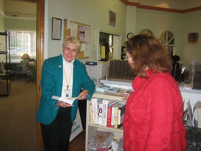 Judy Atkin and Maritza Smidy examine the new books. Both have been HCHL supporters for many years. Judy was our Treasurer in 2003.