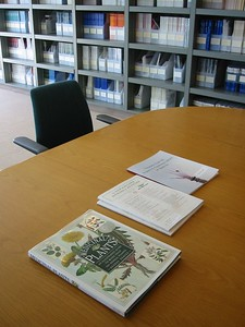 Library with display of medicinal plant book.