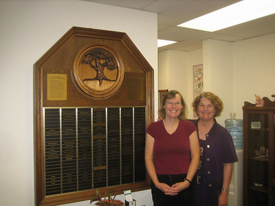 Candace asked me to pose with her next to this plaque which her husband carved.