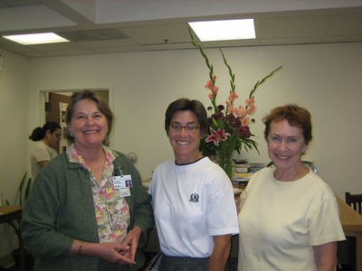 """Candace Ford and two authors in the Library's summer  health lecture series, Tami Anastacia (""""Exercising in the real world"""") and Betty Auchard (Rhythms of widowhood).  Staff member Oralia Tercero is in background.  Oralia used to work at the PlaneTree library branch in a community center in San Jose, and gave me a tour there several years ago."""