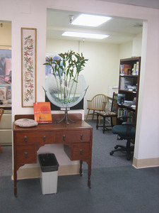 View into alcove with computers (behind vase). On left is entry to video alcove.
