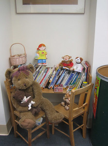 Children's books in nook along wall of main room