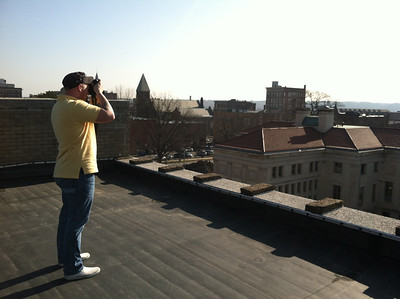 "Jeffrey Byrnes photographing the Library from the roof of the Masonic Lodge. March 20, 2012.  An auction and exhibition (""Landmark Illuminations"") of his library photographs was held at Open Square (March 30) as a benefit for the Library."