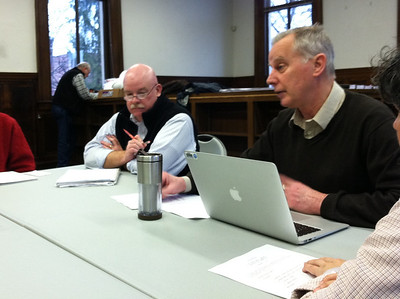 January 13, 2012.  Renovation Committee Meeting, chaired by William Fuqua, left, Holyoke Dept of Public Works.  Terry Plum, President of the Board of Directors of the Holyoke Public Library Corporation, right. (María Pagán, Library Director, is barely visible in right foreground.)