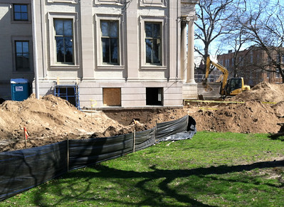 April 4, 2012.   The trench for electrical wiring now connects around to the building. Excavation in progress near foundation by front steps (to prepare for improved drainage)