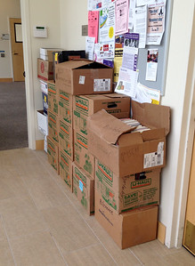 Throughout the weekend, we continued to add books from the basement storage pile. We had hoped that these boxes could be emptied onto the tables as space became available, but this LAST batch of stored books was scarcely opened.  Lessons learned: we had TOO MANY books;  the Community Room was too small for adequate display of all the categories (or, we gave too much of the space to the Mystery and Fiction sections, which were huge); and in spite of newspaper and TV publicity, we did not have large crowds of shoppers.  We raised about $800 and pleased many people who acquired good books at bargain rates.  But we are still faced with a huge clean-up task: thousands of unsold books.