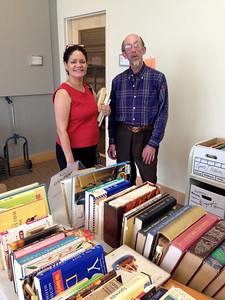 Loida Martinez, former board member of the Friends, and Tim Damon, our Books Sale Chair.