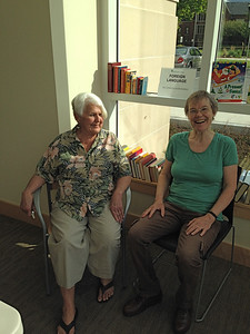 Helen and Sandy relaxing after hours of set up Thursday.
