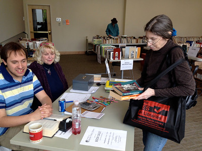 Terrence Smith and Karlene Shea at the cashier's table Saturday afternoon.