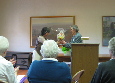 "Maria presented Cathy Dower with an ""Edible Arrangement"", thanking her for her year of service."