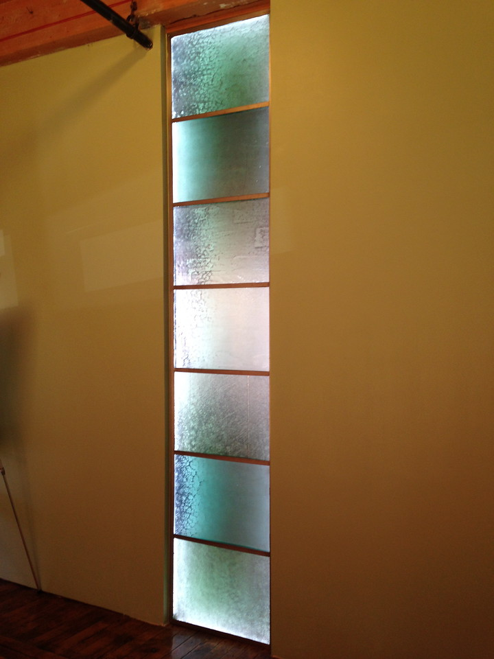 "The Library's old glass panels show varying patterns of wear (from 110 years of use as flooring in the stack wing). John selected interesting examples and arranged them artistically.  The glass is 1"" thick and illuminated here by lighting along the frame.   Lovely!"