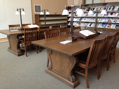 Wooden library tables from 1902 continue to be of service, now refinished and with new chairs and new lighting. In addition to these two in the Periodical Reading room, there are two in the main reading room on Level 1, two in the History Room on Level 3, and one in a small conference room.