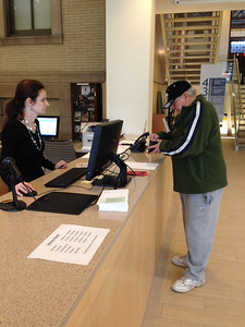 Carla Wessels at the Circulation desk on the ground floor.