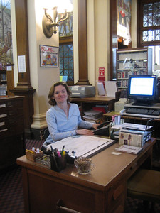 Carla at the main desk, Holyoke Public Library
