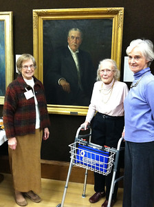 Family members posing with portrait of James Hale Newton: grand-daughter Roberta Newton Brown (left), niece Alice Newton Childs Smith and grand-niece Katharine Childs Jones.