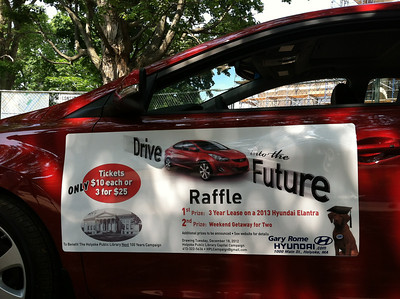 "Gary Rome partnered with the Holyoke Public Library in creating a ""Drive into the Future"" raffle to benefit the Library Campaign.  $10/ticket or 3 for $25.  The drawing will be held in December.  The raffle was announced at a press conference June 22, 2012."