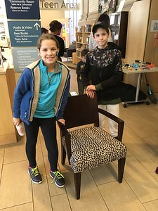 Happy winners of the Cheetah chair, donated by Conklin Office Furniture