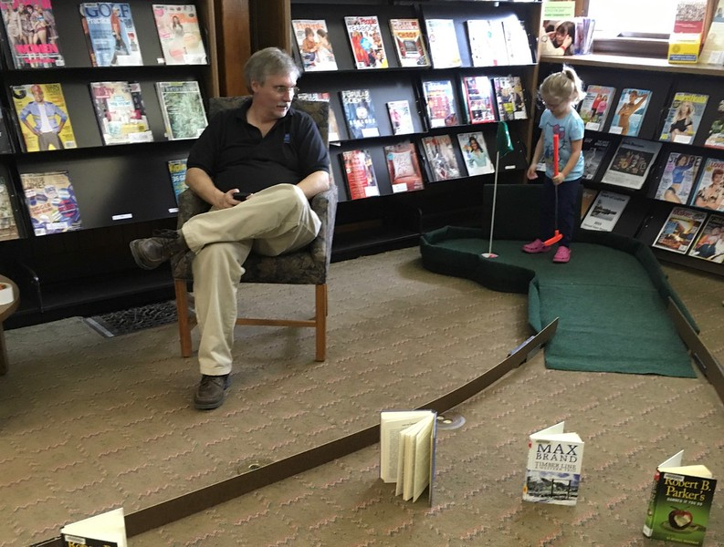 Rick Bolton, owner of Library Mini Golf, LLC, supervising the course at Hubbard Memorial Library, Ludlow, MA, on February 25, 2017.  Sandy went to see their set-up and meet with Rick to review the plan for our 2017 course.