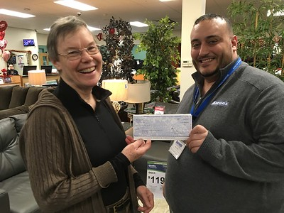 Robert Lopez presenting Aaron's check to Mini Golf chair Sandy Ward, January 27, 2017. Aaron's is sponsoring a PREMIUM hole: the 1st Hole!