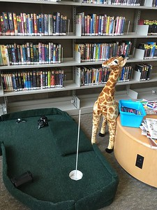 Three giraffes (and a herd of zebras) were added by Russ Bolton of Library Mini Golf LLC.