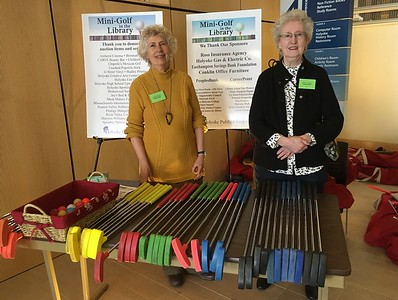 Friends volunteers Bernice Bowler and Peg McCarthy at the equipment table