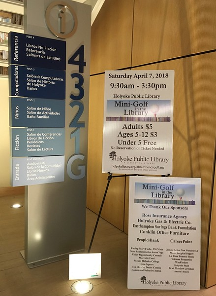 """Signs posted in the library lobby in April.  (The small bottom sign advertises a """"practice hole,"""" which arrived in advance.)"""
