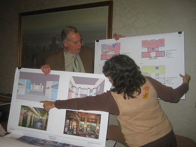 """Terry and Maria explain some changes made in response to advice from historic preservationists:  the """"ears"""" of the original building will now be preserved."""