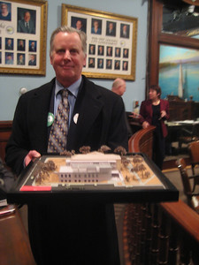 HPL Board President Terry Plum with model from an earlier schematic design process.