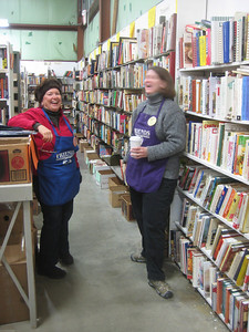 Volunteers Peg and Tammy having fun in the COOKBOOK section.  Each subject section is managed by a specific volunteer, who does the fine sorting and decides what to keep (e.g., how many copies of a title, what editions).