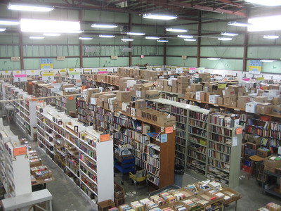 "This entire Book Sale area, now getting stocked up for the spring sale, will be cleared after the sale.  Prices decrease near end of sale: ""Dime Day"",  then ""Bag Day"" (fill a plastic bag for $1), then Not-for-Profit Day (invite local churches, schools, etc to take anything for free).    Next the volunteers count what's left in their sections and have a big PIZZA PARTY. The remaining items are given to Better World Books, or a similar org, to send to Third World and/or recycle."