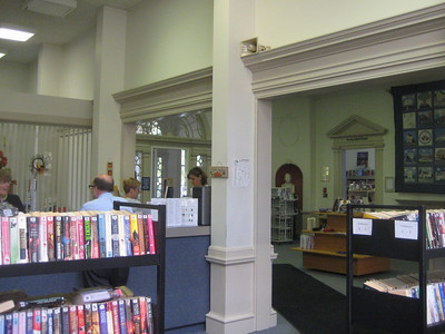View of Circulation desk (left), main entrance, and Young Adult Room (right, in distance)