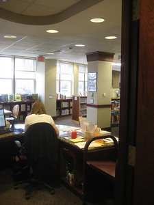 View from work space for Children's Librarian (conveniently adjacent to Circ desk work space, so staff can flow between the 2 service points),  looking out to Children's Library.