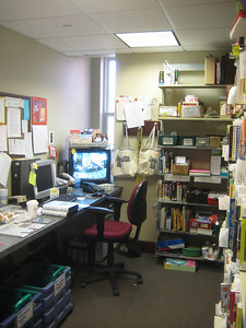 Work spaces near Circulation (e.g., interlibrary loan books on right waiting for people to pick up) are crowded.   (Usage has grown in the years since this was designed.)