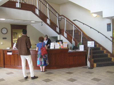 Main lobby inside front doors. Circulation desk.  Stairs up to main collection.