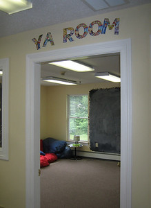 I like the casual space for Young Adults, with chalkboards on wall.  Note: Library staff say that younger children are drawn to the chalkboard -- so there needs to be another one for the younger set.