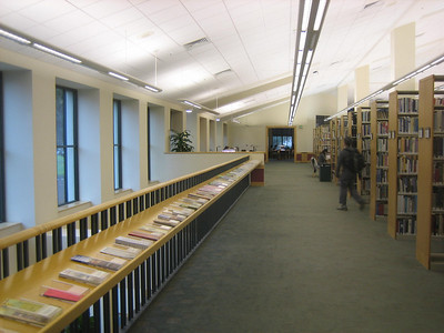 Display racks along 2nd floor stair rail, Mtn View Public Library, CA.