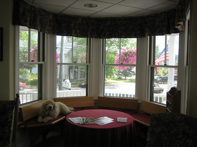 Wonderful use of corner window area. (The dog is not real)