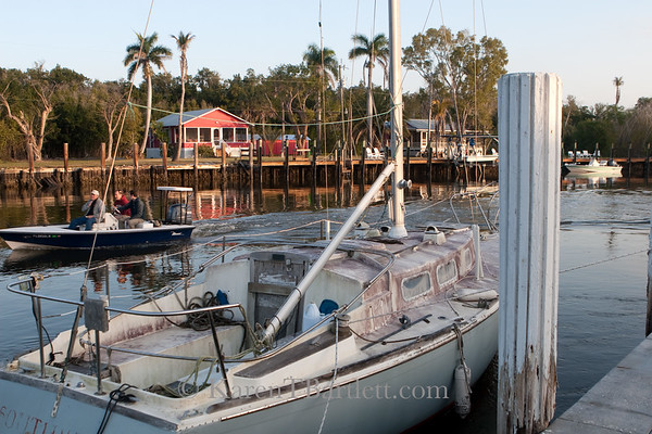 9156 Red cottages and fishing boats on  the Barron River in Everglades City, Florida
