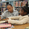 Lynn, Ma. 10-3-17. Danielle Hairston, and Alivea Hairston, right, reading the the Lynn Public Library.